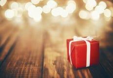 Gift box and Christmas garland Royalty Free Stock Photo