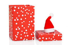 Gift box with christmas hat Royalty Free Stock Image