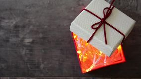 Gift box with Christmas lights inside. Footage. stock video footage