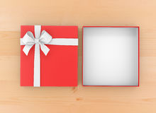 Gift. Box for Christmas, New Year's Day ,Open red   box top view wood table background 3d rendering Royalty Free Stock Images