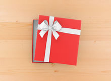 Gift. Box for Christmas, New Year's Day ,Open red   box top view wood table background 3d rendering Stock Photos
