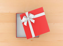 Gift. Box for Christmas, New Year's Day ,Open red   box top view wood table background 3d rendering Stock Photography