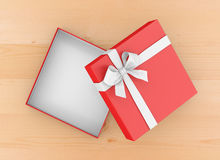 Gift. Box for Christmas, New Year's Day ,Open red   box top view wood table background 3d rendering Stock Image