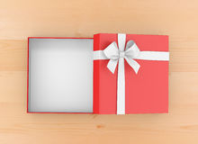 Gift. Box for Christmas, New Year's Day ,Open red   box top view wood table background 3d rendering Royalty Free Stock Image