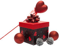 Gift box with christmas ornament Royalty Free Stock Image