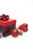Gift box with christmas ornament Royalty Free Stock Images