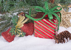 Gift Box and Christmas Ornaments Royalty Free Stock Photos