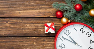 Gift box and clock with christmas baubles Royalty Free Stock Photo