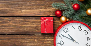Gift box and clock with christmas baubles Royalty Free Stock Photography