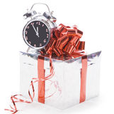 Gift box with clock over the white Royalty Free Stock Image