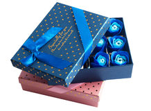 Gift box closeup. And blue rose buds isolated on white background stock images