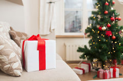 Gift box on coach at home Royalty Free Stock Photo