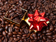 Gift box in coffee beans Royalty Free Stock Photo