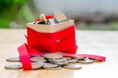 Gift box with coin Stock Photos
