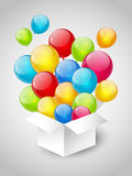 Gift box with balloons. Gift box with color balloons on grey background Royalty Free Stock Images