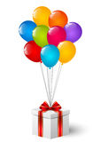 Gift box with color balloons Royalty Free Stock Images