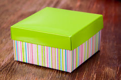 Gift box with green cap Royalty Free Stock Image