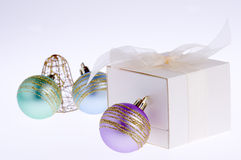 Gift box and colorful baubles Stock Image