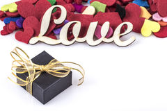 Gift box and colorful hearts on white for valentine. Valentines Day template with hearts and gift on white Royalty Free Stock Photography