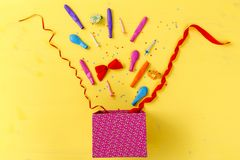 Gift box with colorful party items Royalty Free Stock Images