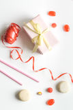 Gift box with colorful party items white background top view Royalty Free Stock Photography