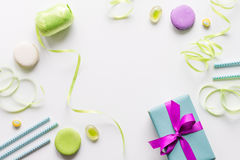 Gift box with colorful party items white background top view Royalty Free Stock Photos