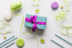 Gift box with colorful party items white background top view Stock Photo
