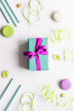 Gift box with colorful party items white background top view Royalty Free Stock Image