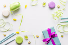 Gift box with colorful party items white background top view Stock Photography