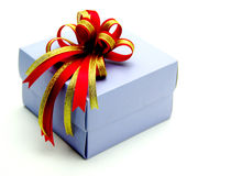Gift Box with Colorful Ribbons on White Background Royalty Free Stock Images
