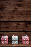 Gift Box. Colorful Gift Box on Wooden Stock Images