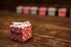 Gift Box. Colorful Gift Box on Wooden Stock Photography