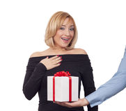 Gift box concept. Close up of man giving gift box to woman Stock Photos
