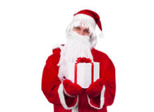 Gift box concept. Santa Clause holding gift box Stock Photos