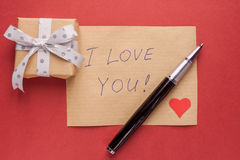 Gift box and confession letter Royalty Free Stock Images