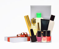 Gift box with cosmetics on white Stock Images