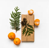 Gift box in craft paper on white background. Christmas or other holiday concept, top view, flat lay Stock Images