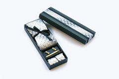 Gift box with cufflinks, tie and tie clip, handkerchief. Royalty Free Stock Photography