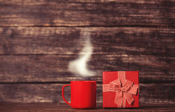 Gift box and cup of coffee Stock Photos