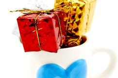 Gift box in a cup Royalty Free Stock Image