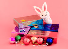 Gift box and cute bunny on sweet pink background Royalty Free Stock Photography