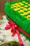 Gift box with dandelions and leaves Stock Photo
