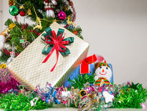 Gift box decorated with Christmas tree. Royalty Free Stock Image