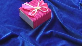 Gift in a box. Decorated with colorful ribbons stock video