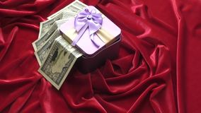 Gift in a box. Decorated with colorful ribbons stock footage