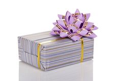 Gift box decorated with a golden tape and bow Royalty Free Stock Photography
