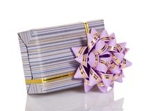 The gift box decorated with a golden tape Stock Photo