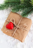 Gift box decorated with red heart Royalty Free Stock Image