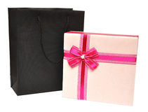 Gift box decorated with ribbon and black bag Stock Images