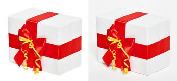 Gift box decorated silk red ribbon and bow, object on white studio background Stock Photo